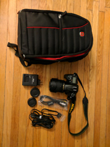 Nikon D7000 DSLR /w 18-105mm lens and Swiss Gear camera backpack