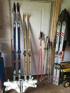 3 pairs of skis and poles, one pair size 9 boots.