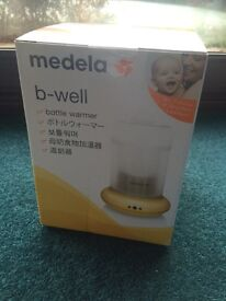 Medela bottle warmer - new - sealed box