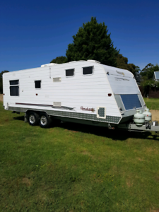 Family caravan double bunks shower and toilet.