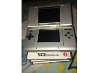 Grey nintendo ds, games and charger