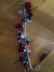 Handmade red rose bracelet