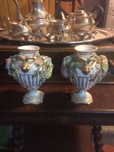 Pair of seves pottery vase is for sale. $80