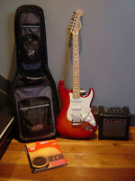Fender Stratocaster Guitar and Roland Amp