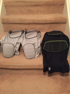 Football Pads - 2 pairs of pants and 1 shirt.
