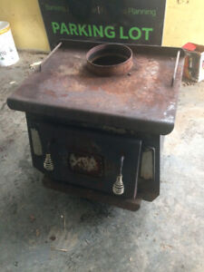 Standing wood stove for sale 200.00 OBO