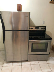 Stainless steel top freezer bottom fridge & electric stove oven