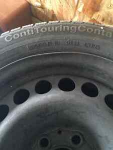 Four 205/55 R 16 all season Continental tires on rims for sale