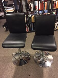 Black leather bar stools from Bo Concept
