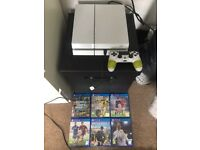 PlayStation 4 with games and controller