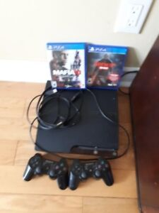 PS3 for sale with two controller two games