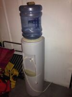 water cooler and 2 jugs