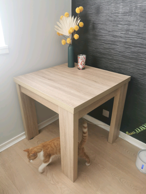 next furniture  extendable dining table 2 side tables
