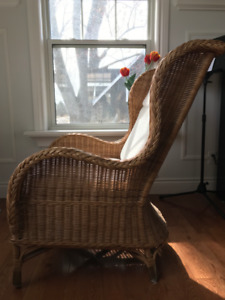 Wicker IKEA wingback chair with white cushions
