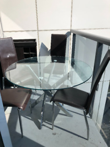 A set of table with 4 chairs.