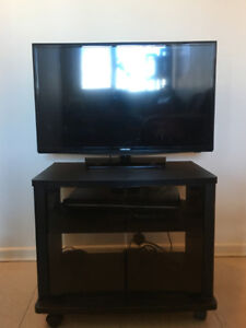 Samsung TV with TV stand