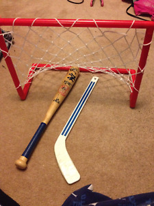 Mini Hockey Stick and net + NY small wooden bat $20 for lot
