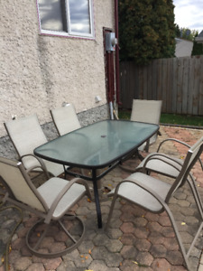 Patio Set - glass table with umbrella,  6 chairs, 1 lounger