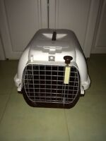 Medium/ small pet carrier with secure locking gate.