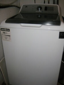 8 month old GE. 5.4 top load wash machine for sale