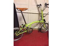 Lime Brompton folding bike, leather seat