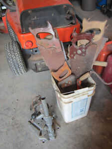 Bucket of saws, hand drill, auger