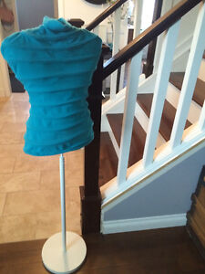 IKEA clothes hanger with teal cover