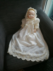 Antique porcelain infant and friends.
