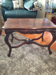 Beautiful antique walnut table with scroll designs
