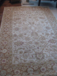 Brand new Persian rug in gold tones