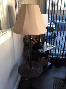 Indoor/outdoor lamp and table combo.