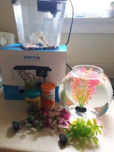 2 female guppieaFish tank,bowl,food,plants ,gravel and plants