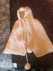 Handmade knitted baby cape