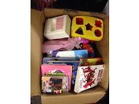 Box full of girls toys, books and pink pram