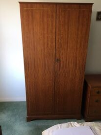 Two matching solid wood wardrobes. Offers welcome