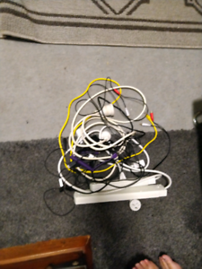 Pile of cords, cables and powerboards