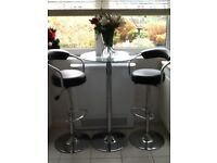 Pedestal Glass and Chrome Table and Two High Chairs