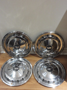 "Set of 4 - 1957 Chevy 14"" Hubcaps."