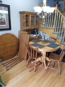 Dining room table and chairs set with a hutch