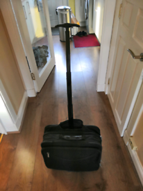 Briefcase with wheels. Pending uplift