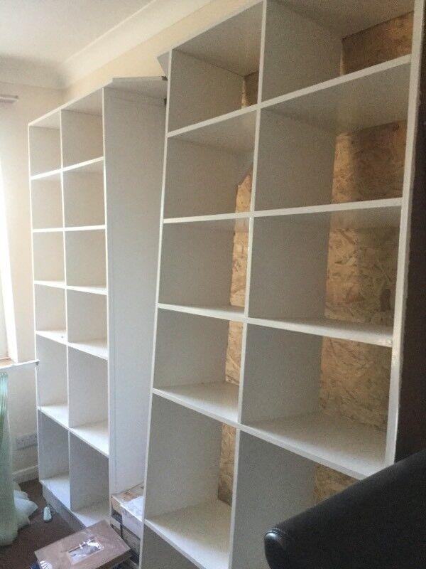 Large white wooden shelving units