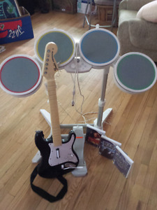 Wii Rock Band set. Guitar, drums, original games