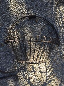 Wrought iron garden baskets, hooks and wall planters