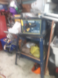 like new table saw on stand , work table and work stand