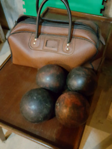 Set of 4 bowling balls and bag. $20 OBO