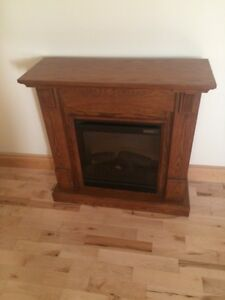 Solid oak electric fireplace in perfect condition asking $350