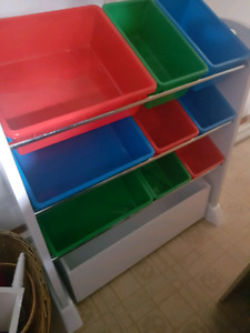 Storage unit with 9 bins plus drawer on coasters