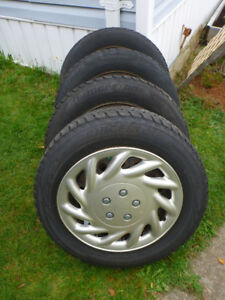 Set of 4 Winter Tires 205 65 16 on rims with hub caps