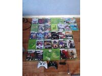 xbox 360 com's with about 34 games 2 controllers 60 gb hard drive nd more