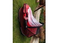 Quinny Buzz carry cot in red